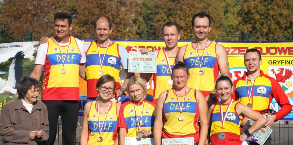 Reprezentacja Delfa w biegu otwartym im. Ludwika Alchimowicza, który rozegrany został podczas Masowych Biegów Przełajowych w sobotę 6 października 2018 roku.
